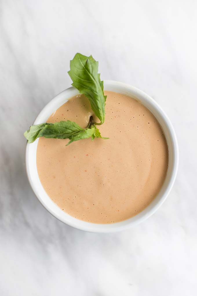 A bowl of a creamy peanut sauce like dipping sauce made with almond butter and coconut milk.