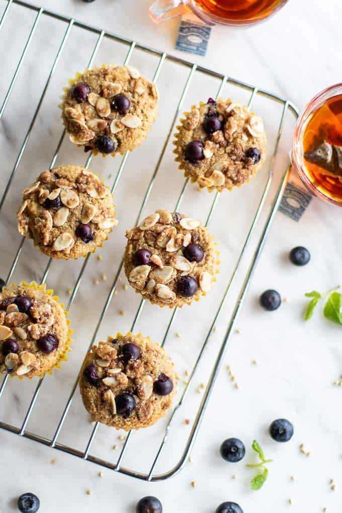 Buckwheat blueberry muffins cooling on a rack.