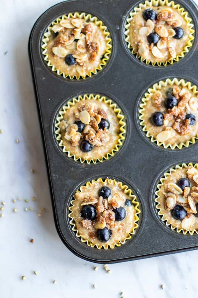 Muffin batter poured into prepared liners, and topped with almond streusel.