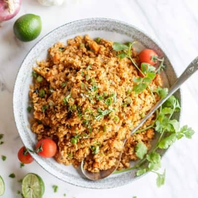 Whole30 rice recipe shown in a bowl with Mexican garnishes.