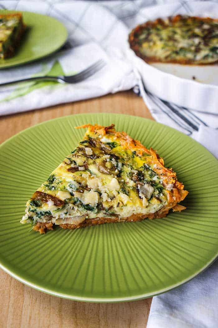 A table set with a frittata and a slice of sweet potato frittata.