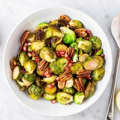 A serving bowl with roasted brussels sprouts.