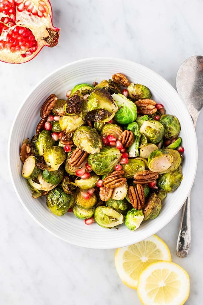 A serving bowl of crispy roasted brussels sprouts.