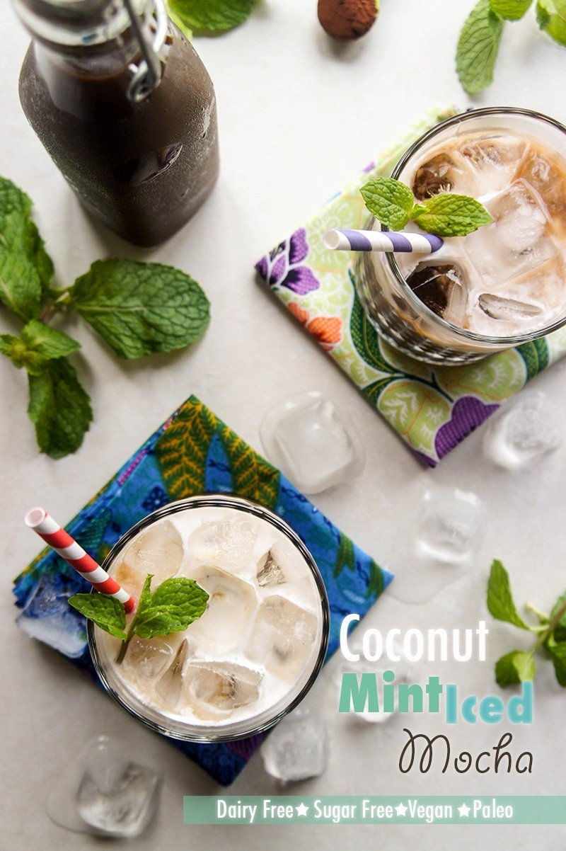 Two glasses filled with a creamy coconut mint iced mocha.