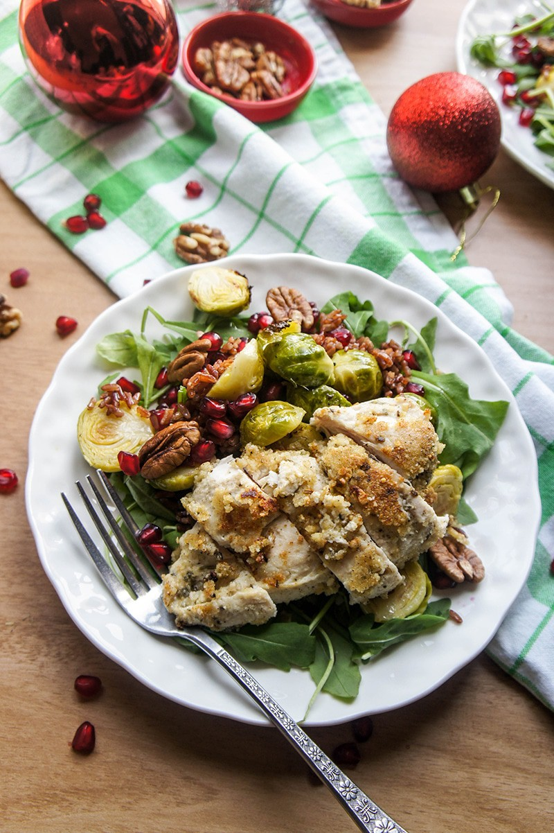 Warm Winter Salad / Red rice, arugula, and roasted brussels sprouts make this warm salad a holiday treat. Topped with pecans and pomegranate for a festive combination.