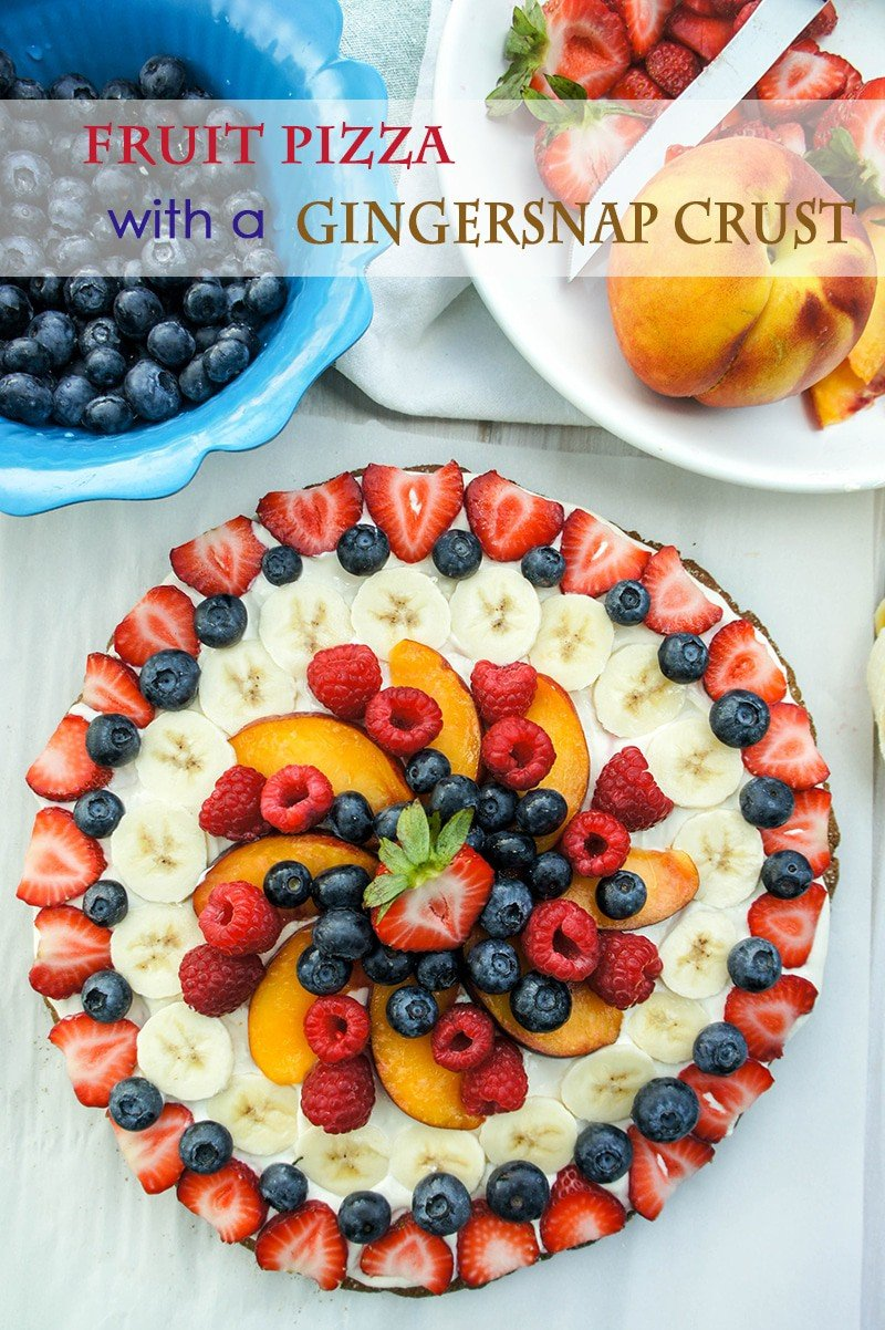 Fruit Pizza with a Gingersnap Crust / This summer stunner is sure to to win over all your dinner guests. This beautiful dessert is low in sugar, so go ahead and serve it for breakfast!