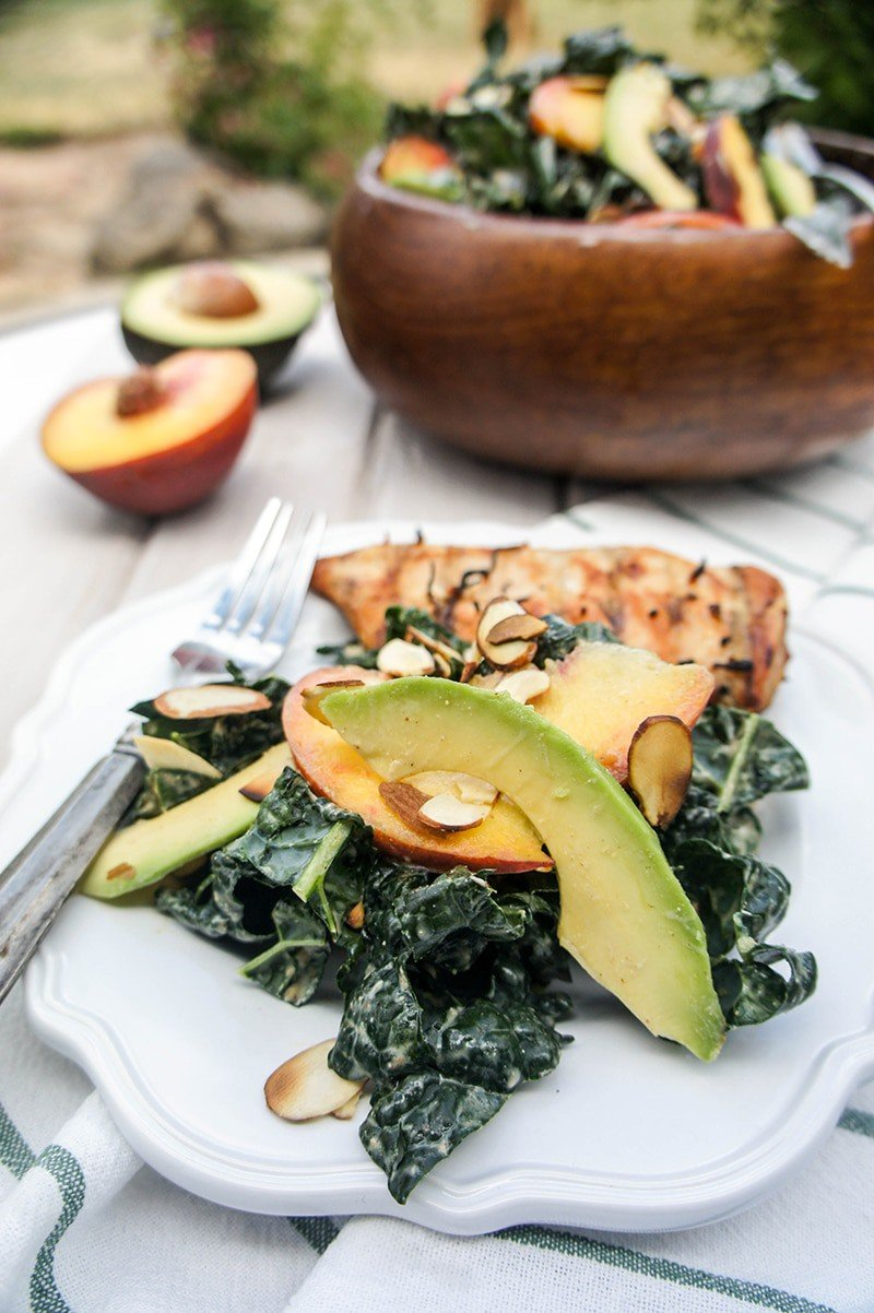 Peach and Avocado Kale Salad / This healthy and fresh summer salad has a creamy ginger-almond dressing. Perfect accompaniment to grilled meats.
