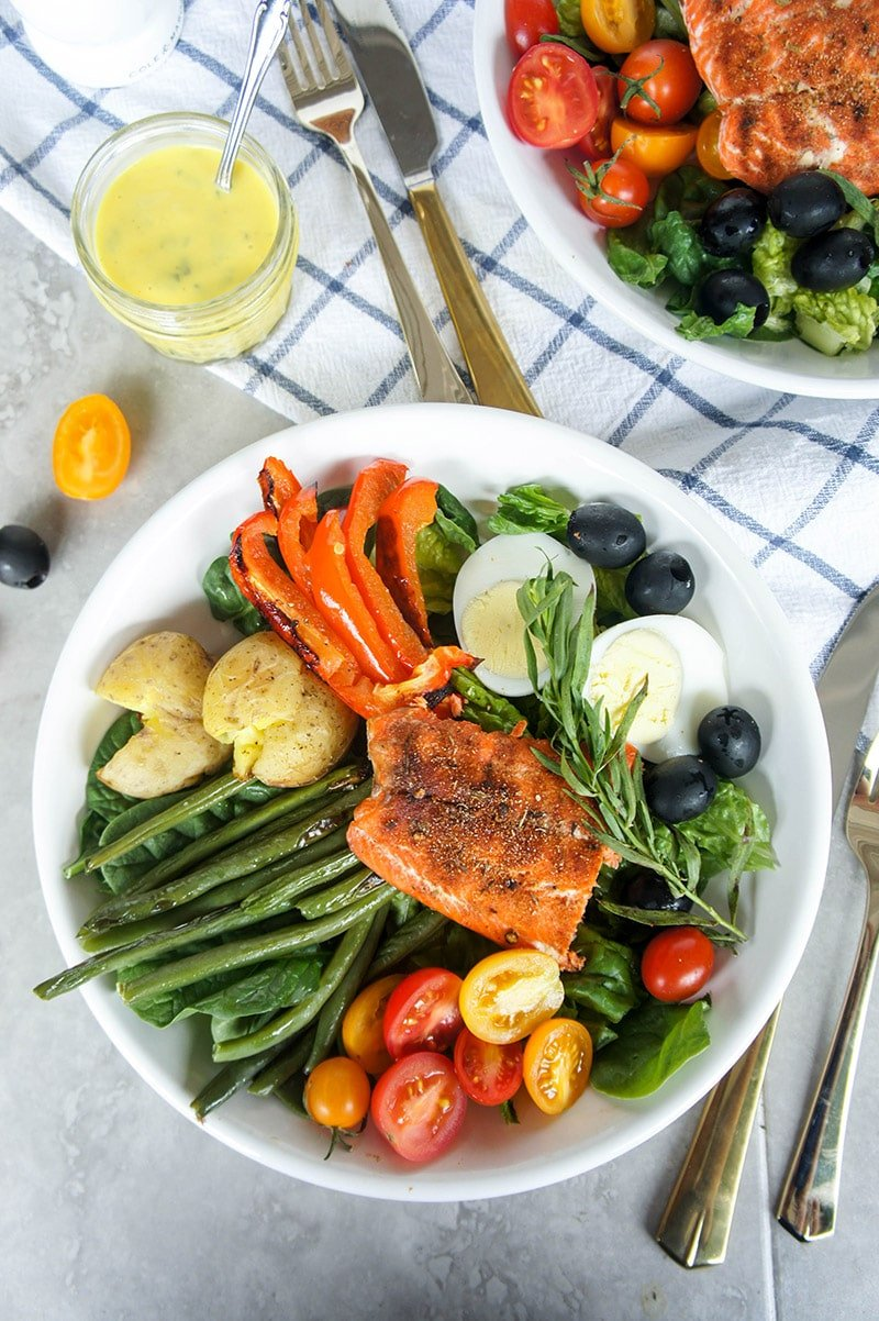 Blackened Salmon Nicoise Salad / This delicious version of a nicoise has spicy blackened salmon and is covered in a luxuriously sweet mango tarragon dressing.
