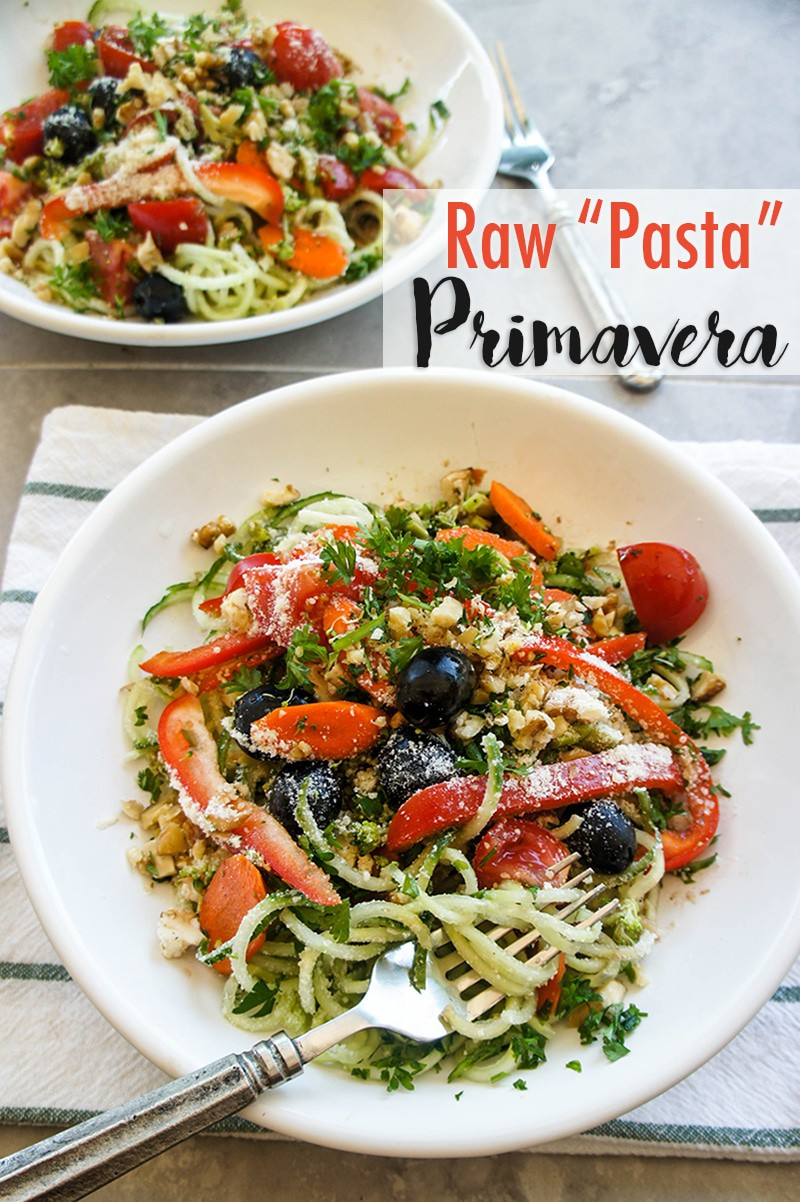 "Refreshingly Light Raw Pasta Primavera / This salad masquerades as a noodle dish! Made light and grain free with cucumber ""noodles."""