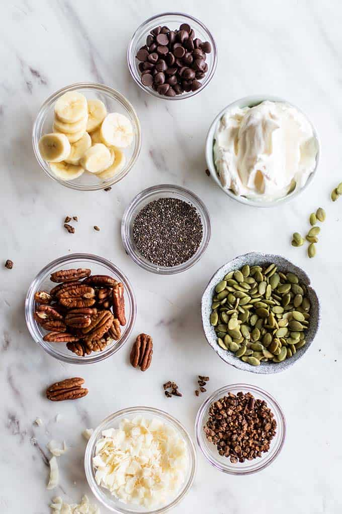 Delicious smoothie bowl topping options shown in small dishes.