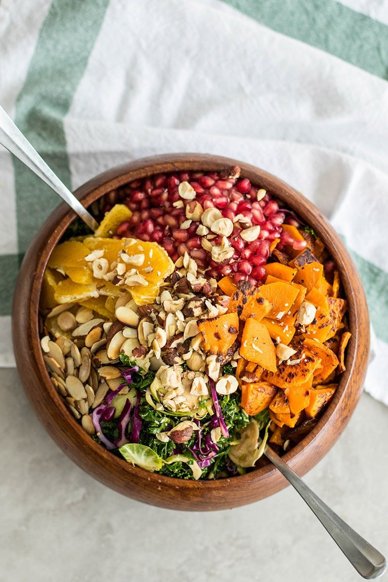 A bowl filled with a colorful winter salad.