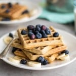 Gluten free waffles topped with a low sugar blueberry syrup.