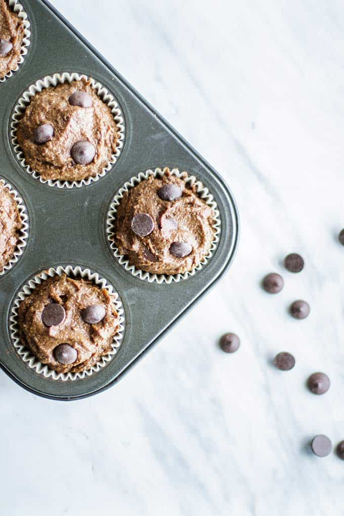 A photo showing to overfill the muffin papers to get nice tall rounded muffins.