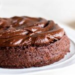 A chocolate quinoa cake with a thick layer of sweet potato frosting.
