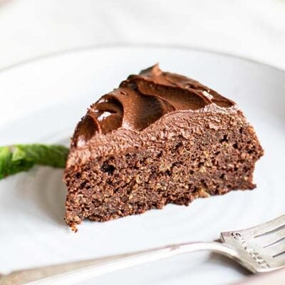 A slice of chocolate quinoa cake with a gold fork.