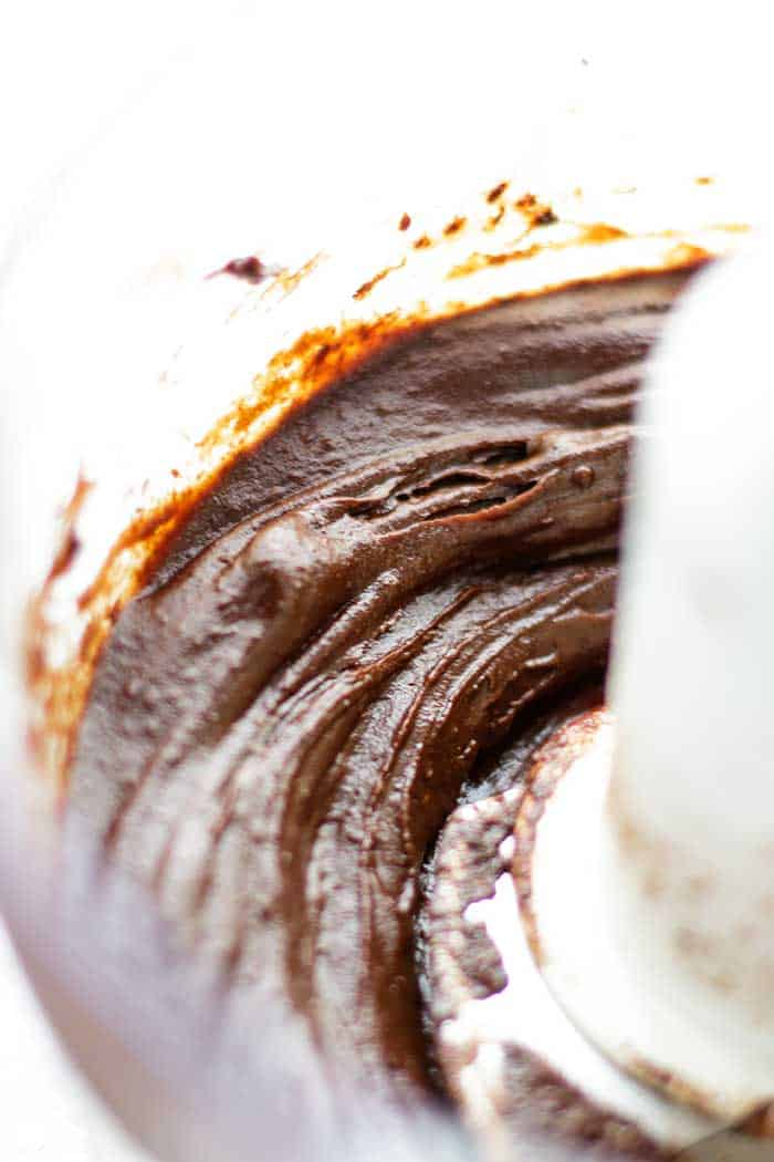 Sweet potatoes, cocoa and coconut oil and processed into a fudgey paleo chocolate frosting.