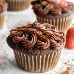 Healthy chocolate frosting piped onto a chocolate cupcake.