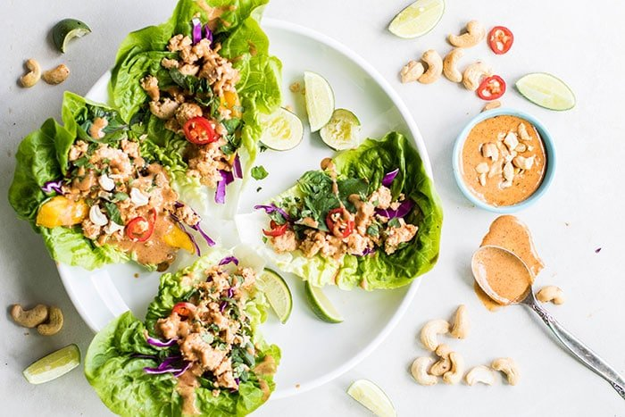 Thai Chicken Lettuce Wraps / These are a flavor explosion! Ginger, chili, and Thai basil make these are super delicious, healthy meal. Paleo and Whole30 compliant.