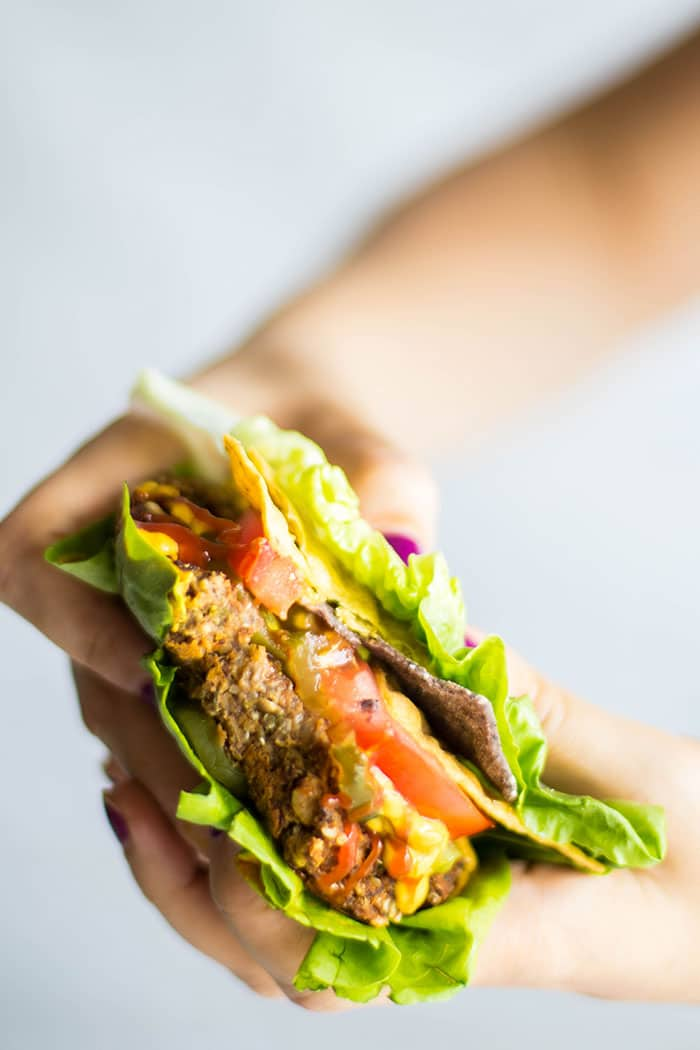 Pumpkin Seed Veggie Burgers / These easy veggie burgers are packed with plant proteins and tons of flavor. Enjoy as a lettuce wrap or on a bun.