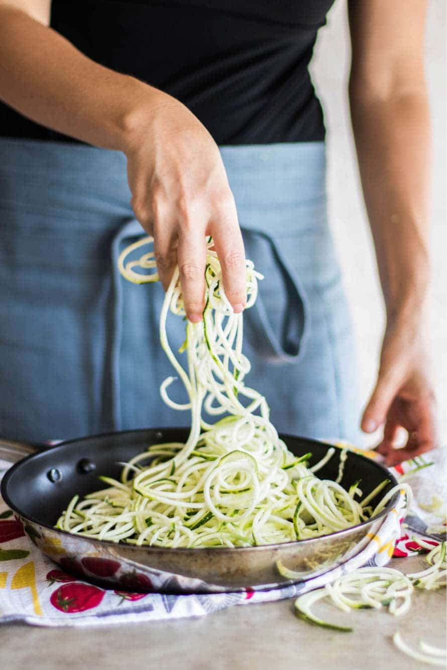 A pan filled with zucchini noodles (zoodles).