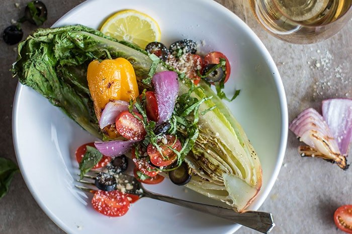 Grilled Romaine Salad / A simple romaine salad is elevated to drool-worth status by being grilled and topped with Italian salad toppings.