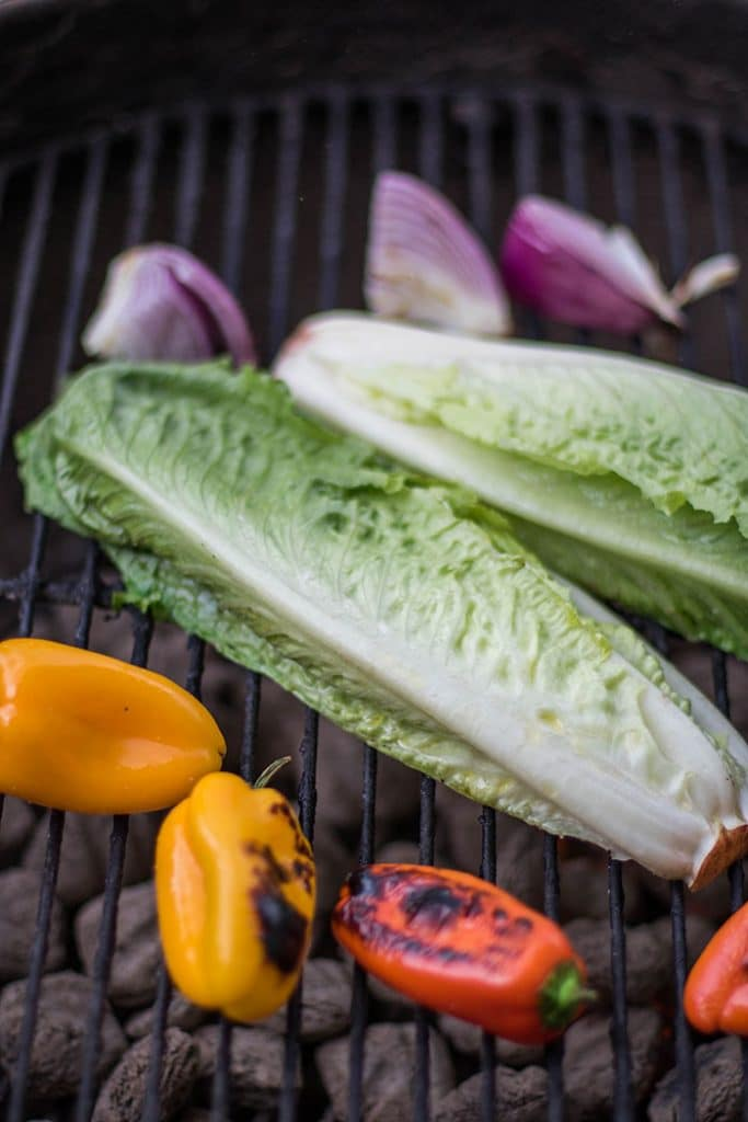 Grilling Romaine Lettuce / A simple romaine salad is elevated to drool-worth status by being grilled and topped with Italian salad toppings.