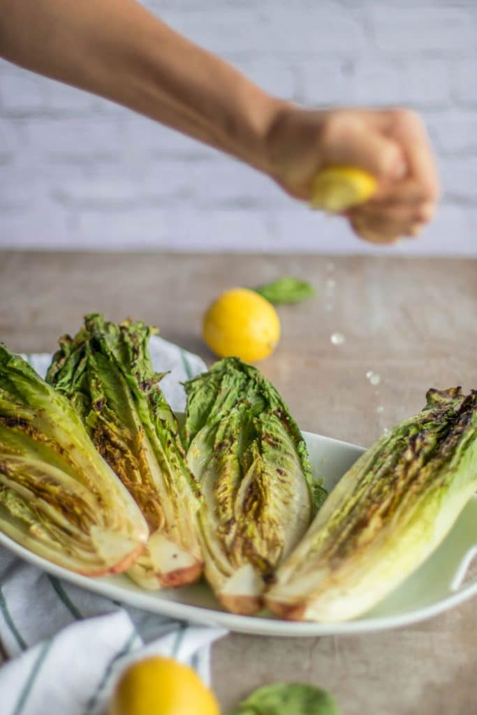 Simple Grilled Romaine Salad / A simple romaine salad is elevated to drool-worth status by being grilled and topped with Italian salad toppings.