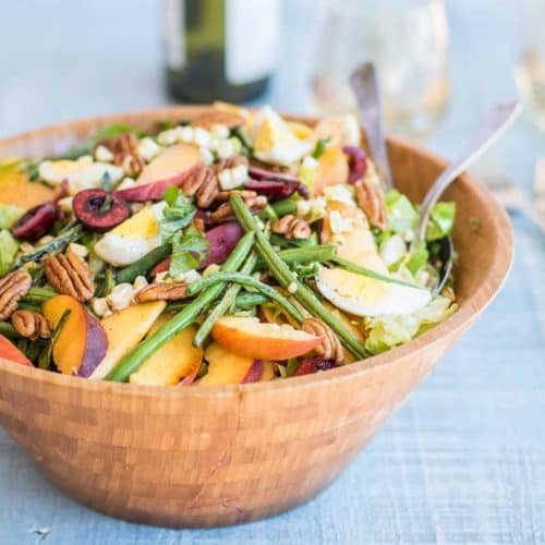 Mid Summer Dream Salad - crisp greens are topped with green beans, corn, cherries and peaches.