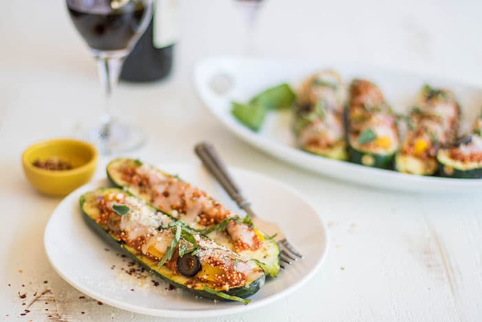 Pizza Zucchini Boats / Have fun with a vegetarian entree on the BBQ this summer. Zucchini is stuffed with a 1-pan quinoa pizza recipe.