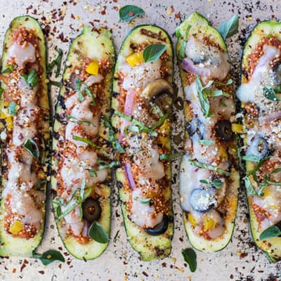 Grilled Zucchini Boats / Have fun with a vegetarian entree on the BBQ this summer. Zucchini is stuffed with a 1-pan quinoa pizza recipe.