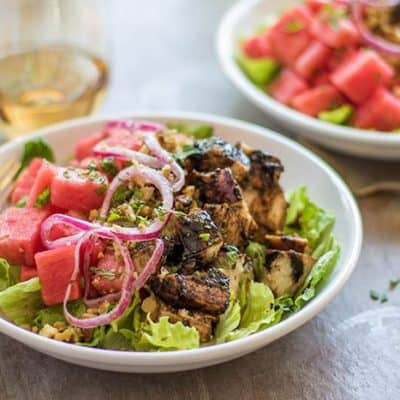 A salad piled high with sticky sweet balsamic chicken and watermelon.