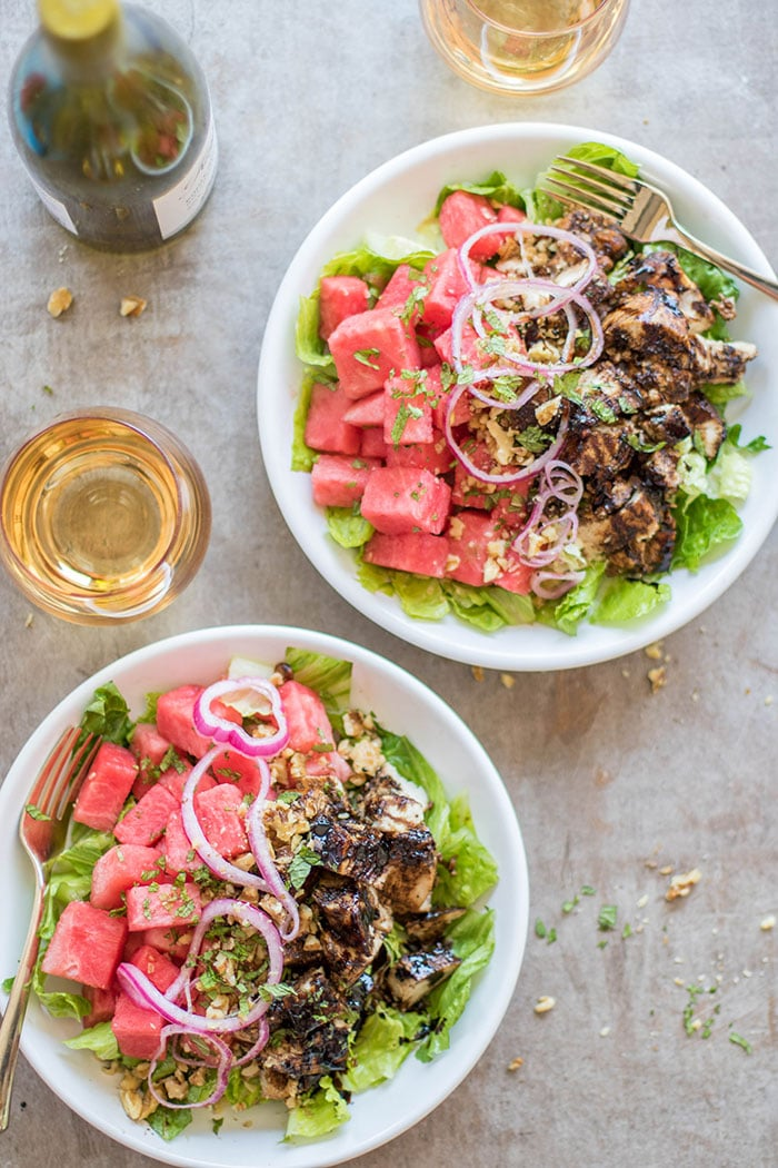 Two plates with a Watermelon Balsamic Chicken Salad
