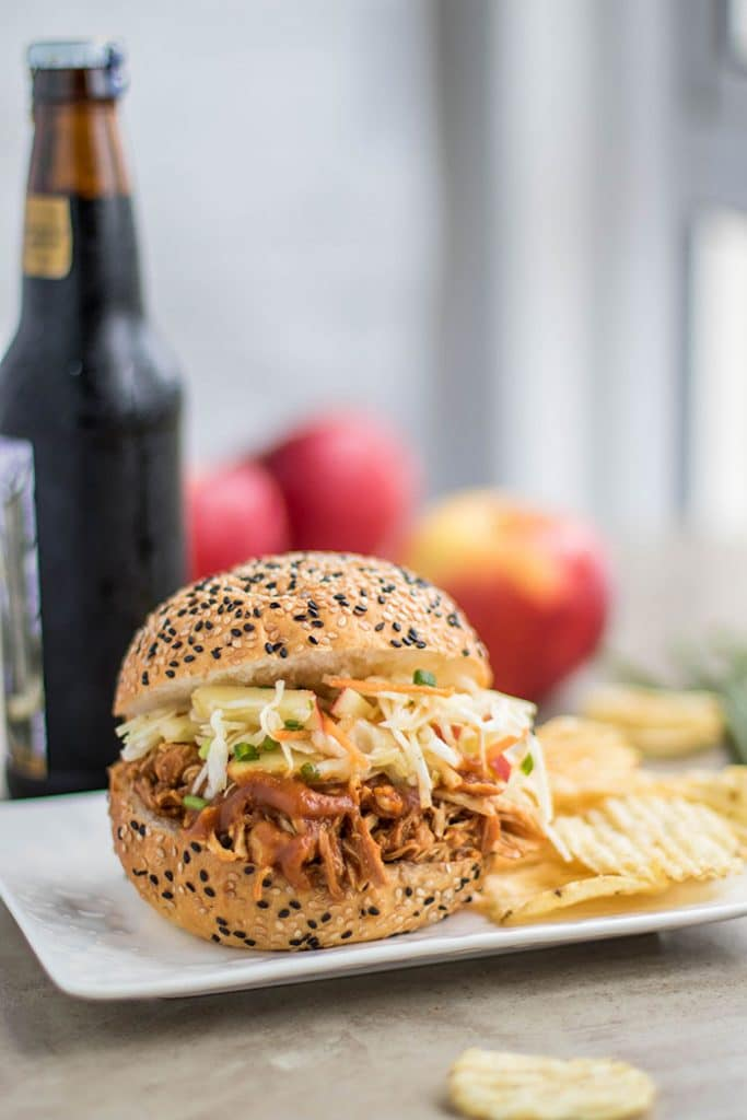 Sweet Onion Apple BBQ Pulled Chicken Sandwich / This delicious sandwich is made with a low sugar apple BBQ sauce, and topped with a tangy apple slaw.