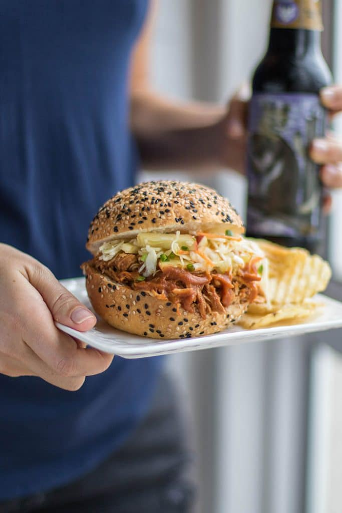 BBQ Pulled Chicken Sandwich / This delicious sandwich is made with a low sugar apple BBQ sauce, and topped with a tangy apple slaw.