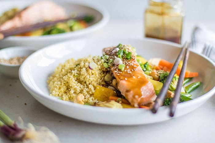 Salmon Teriyaki Recipe / These delicious bowls are loaded with millet, veggies, poached salmon, pineapple and cashews, and drizzled with a flavorful teriyaki sauce.