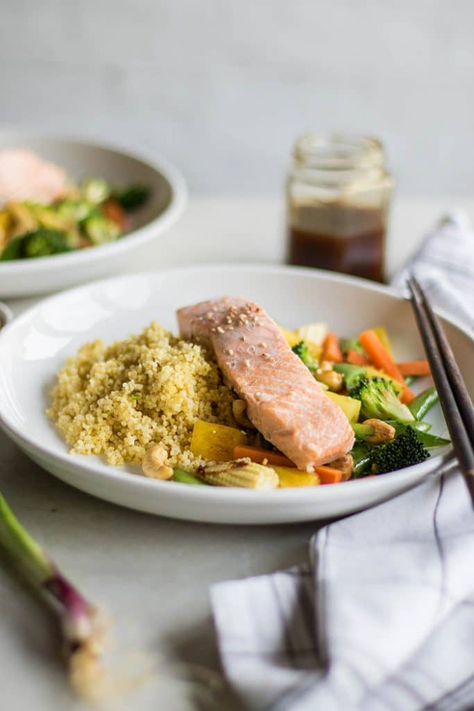 Poached Salmon Teriyaki / These delicious bowls are loaded with millet, veggies, poached salmon, pineapple and cashews, and drizzled with a flavorful teriyaki sauce.