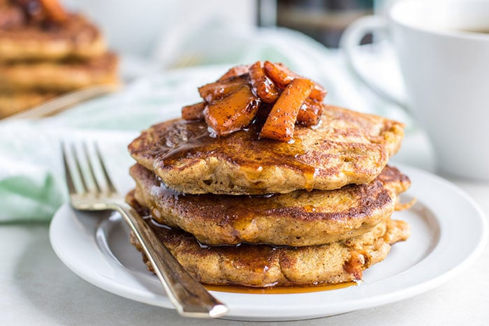 Thick butternut squash pancakes make with oat flour and eggs.