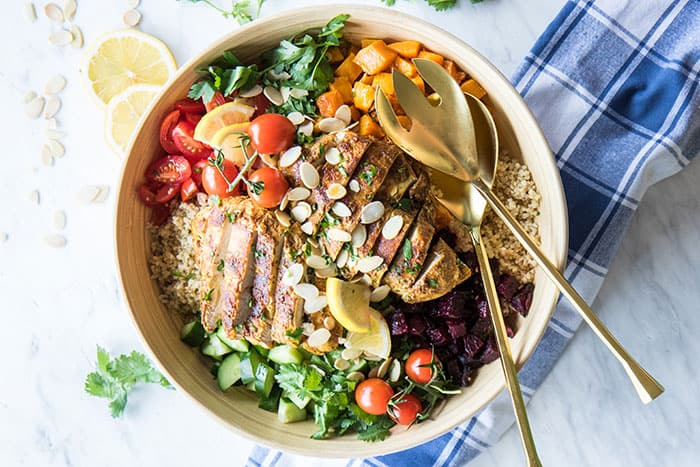 A bowl filled with a healthy moroccan chicken quinoa salad.