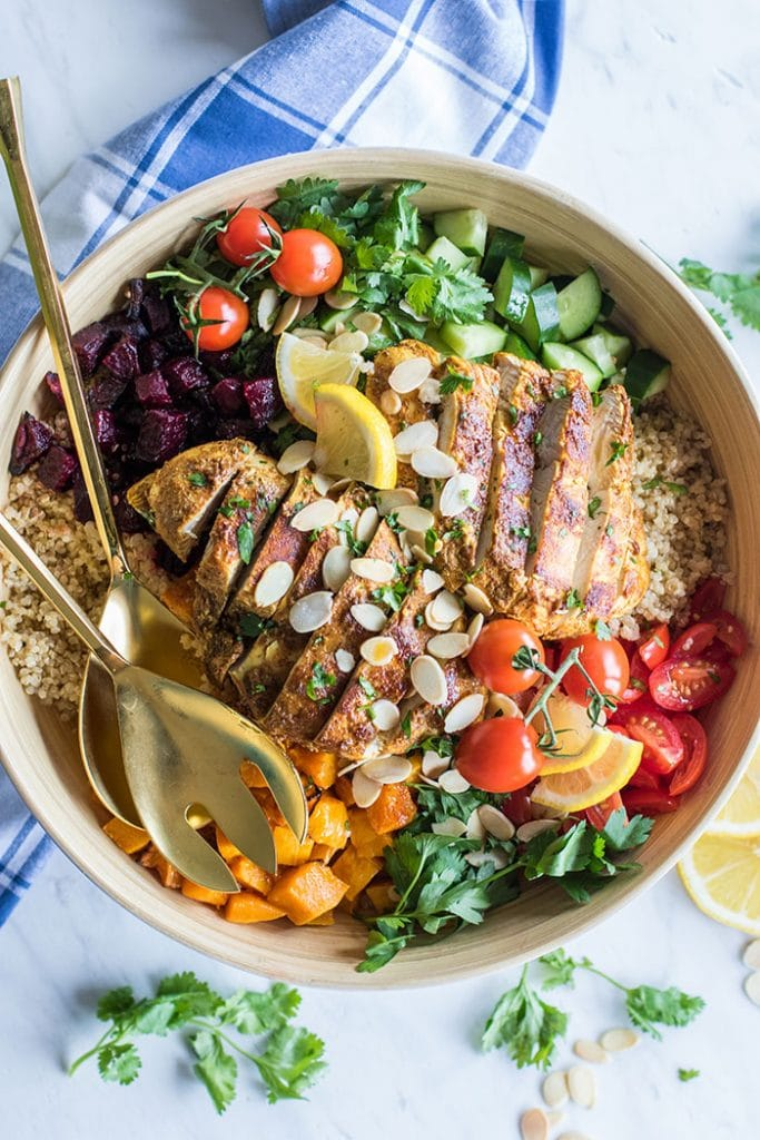 Moroccan Chicken Quinoa Salad / This nutritious gluten free grain salad is filled with vegetables, herbs, and a mouth watering Moroccan spiced chicken.