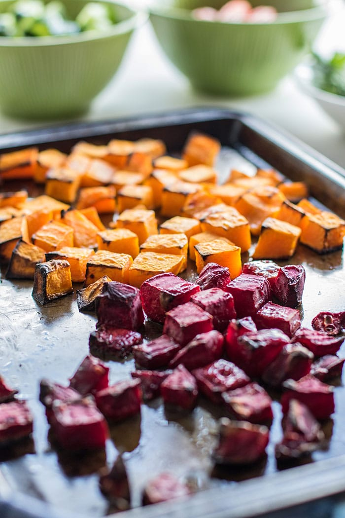 A pan of roasted butternut squash and beets.