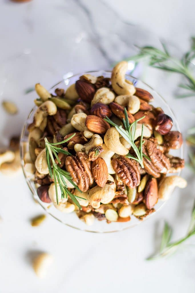Holiday Spiced Mixed Nuts / Toasted nuts are mixed with a flavorful and festive combination of shallots, rosemary, and spices.