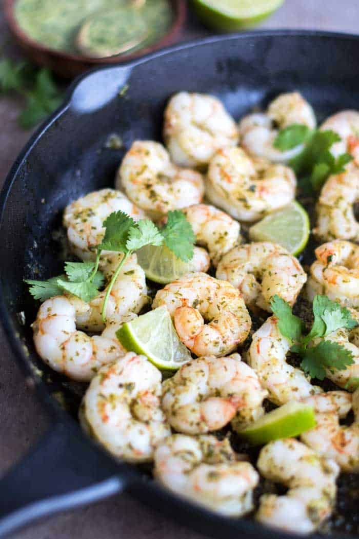 A pan of shrimp marinated in cilantro lime marinade.