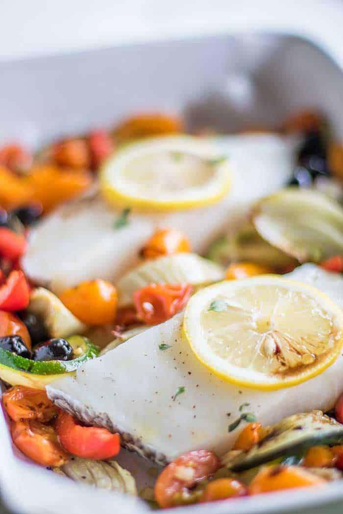 Mediterranean baked vegetables with two cod fillets.