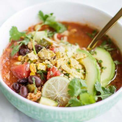 Taco Soup Recipe shown in a blue bowl.