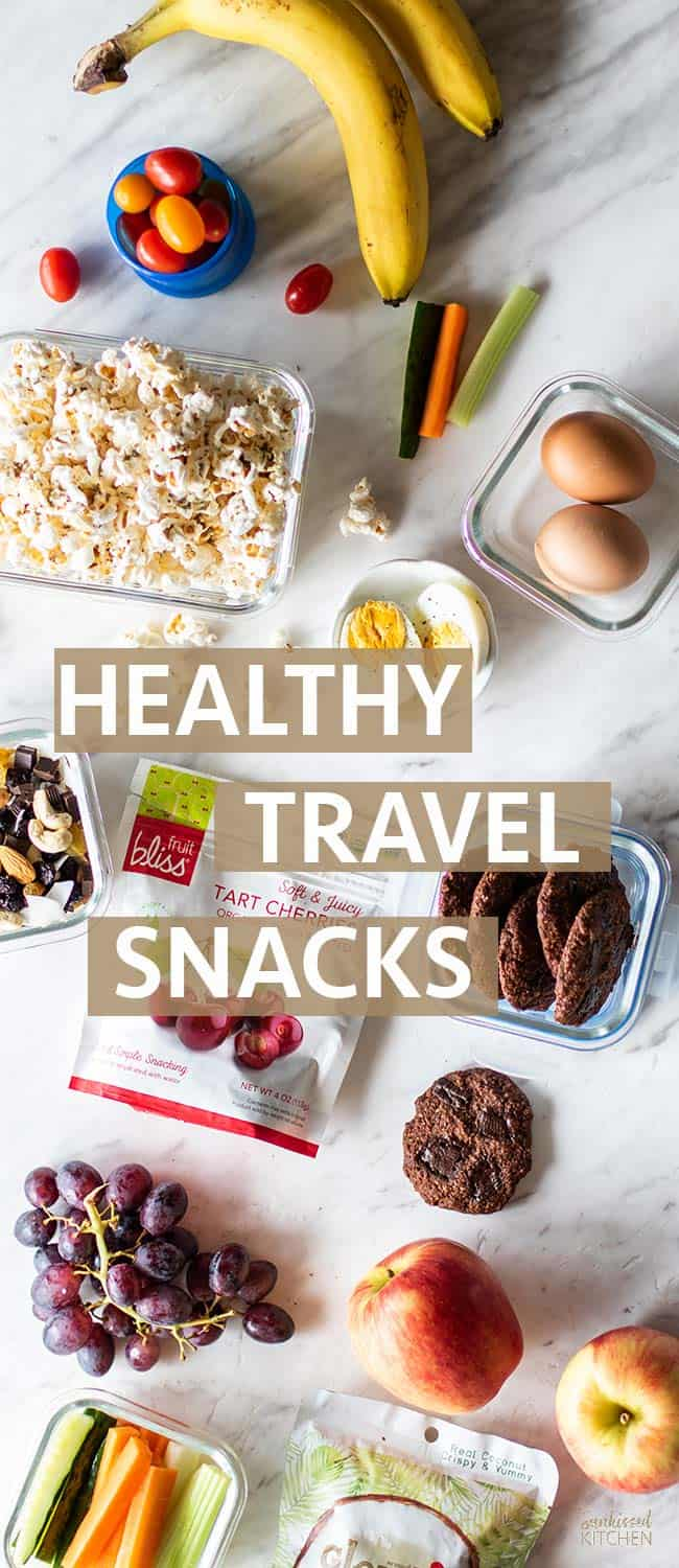 A graphic with tons of healthy plane snacks laid out across a table with passports.