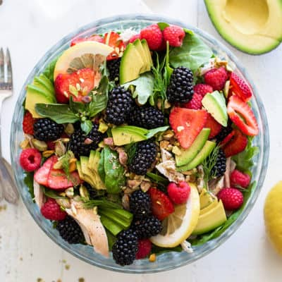 A clear bowl packed with a healthy Whole30 Chicken Blackberry Salad.