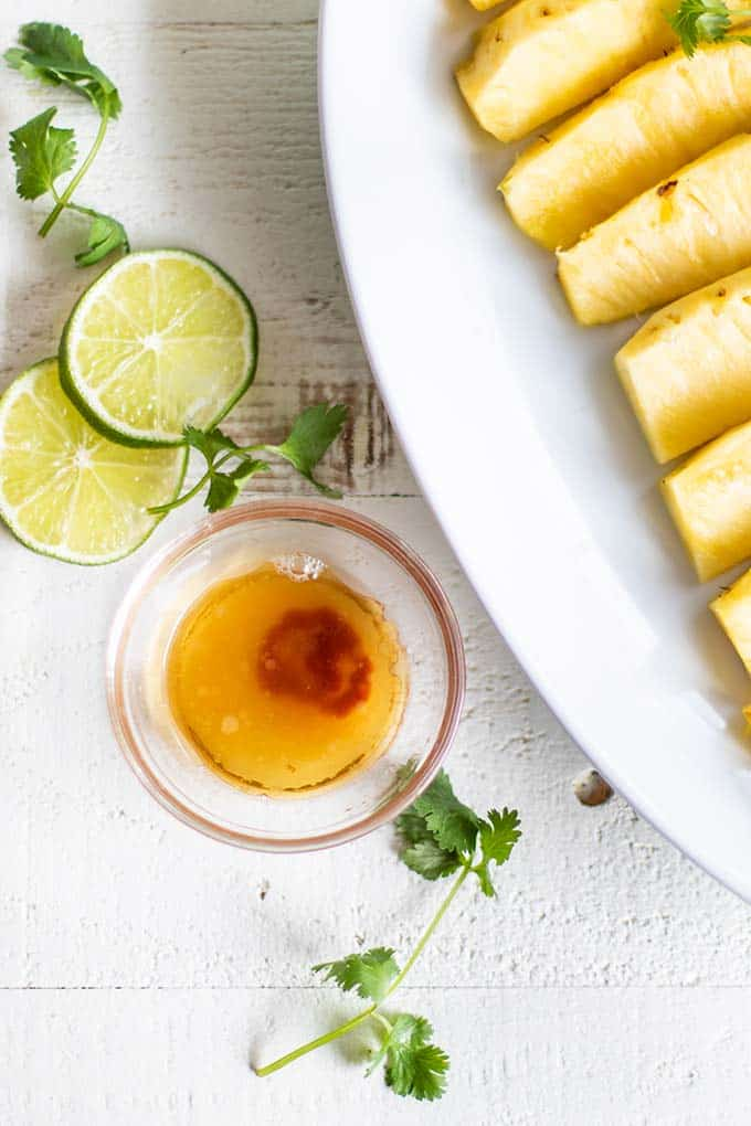 A sour and spicy mix of lime juice, sesame oil and chili sauce used to brush the pineapple.