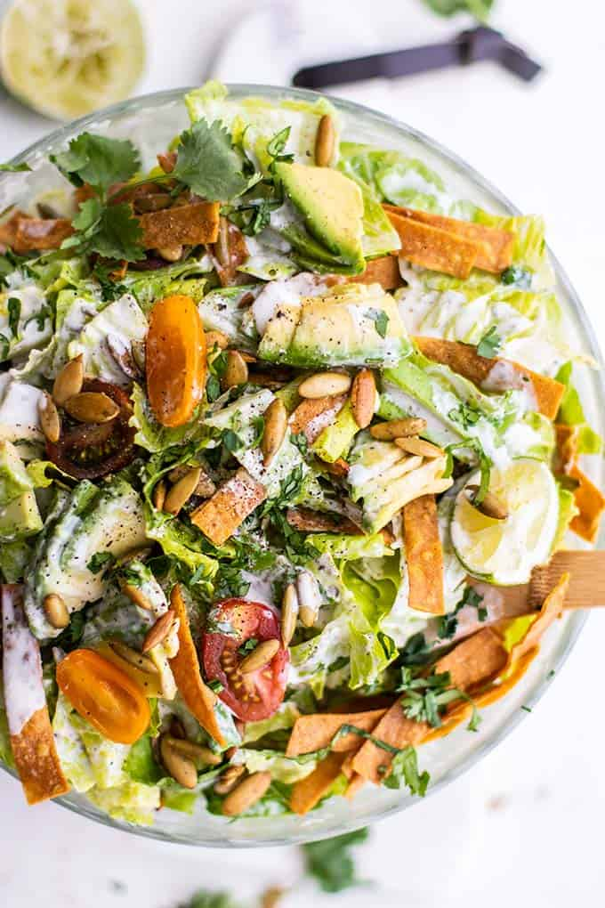 A close up of a Mexican Caesar Salad tossed in a tangy lime dressing.
