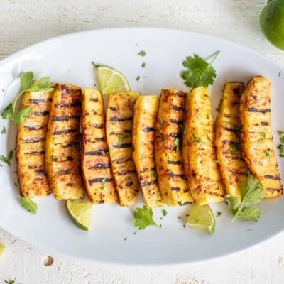 A platter of sweet and spicy grilled pineapple ready to serve.