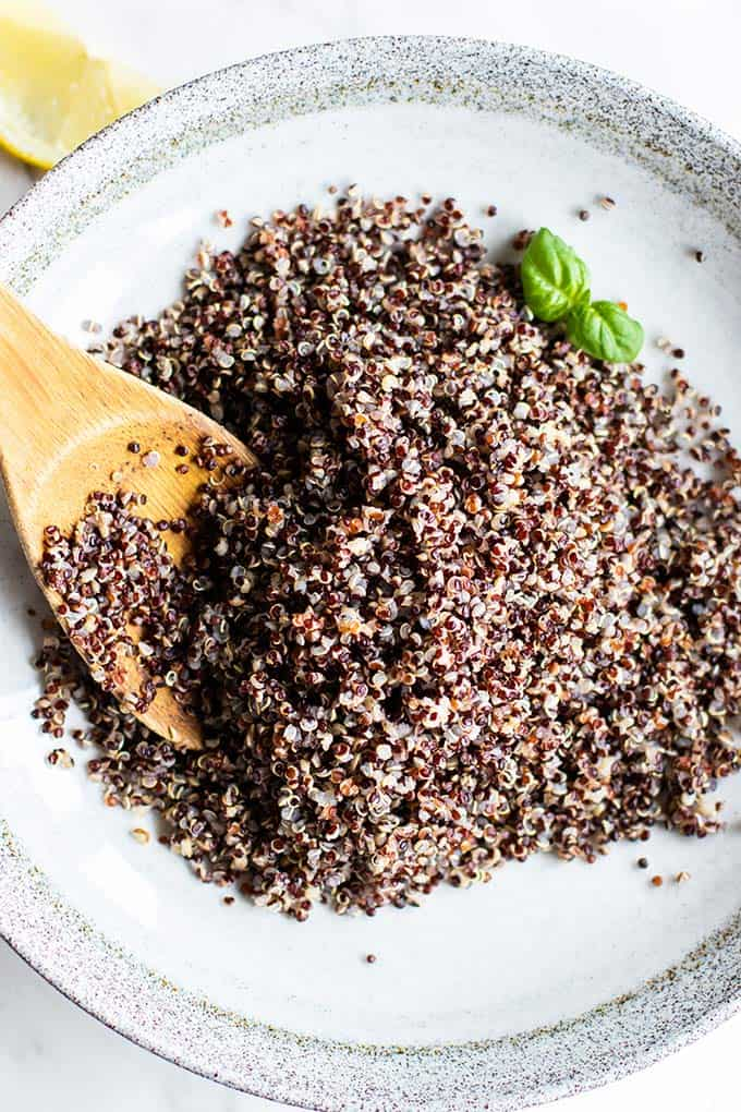 A bowl filled with black quinoa.